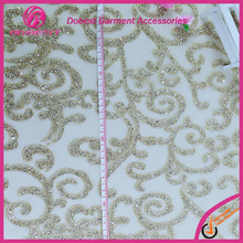 China Wholesale Garment Accessories Embroidery Gold Lace Fabric in Polyester Yarn