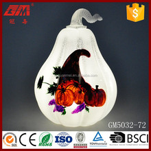 Lighted glass pear-shaped pumpkin decoration