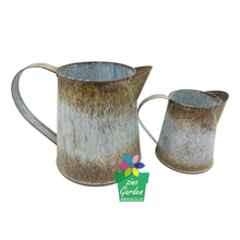 Old vintage style garden decor small antique metal pitchers for watering flower
