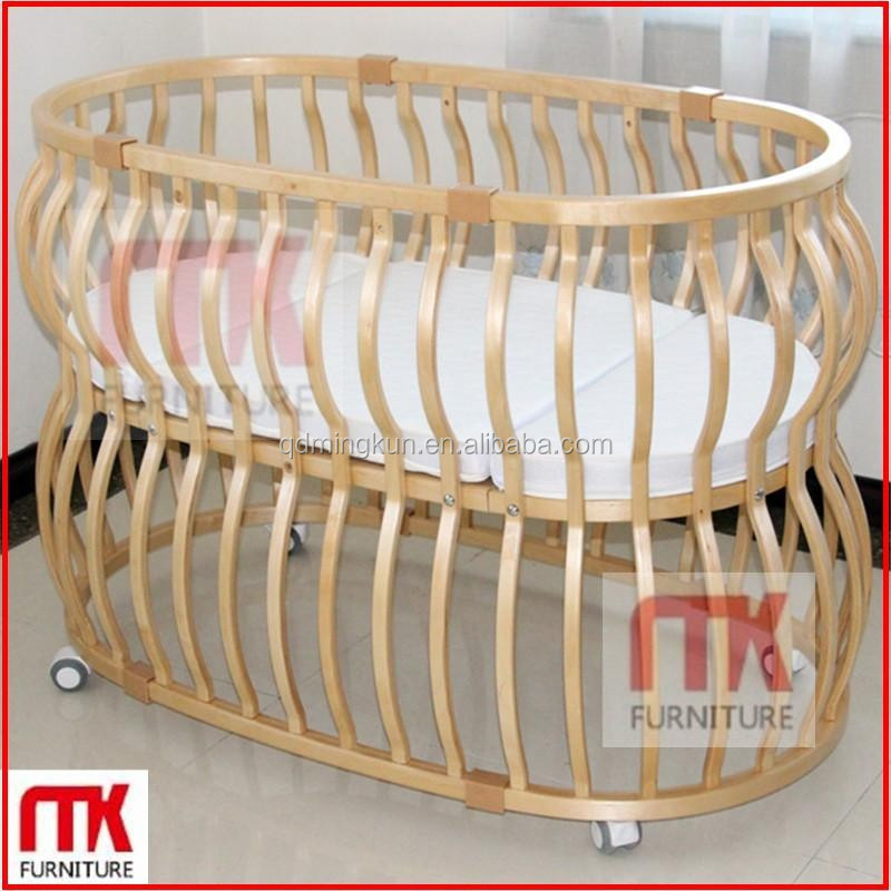 Multi function eco friend wooden baby cribs with wheels for Baby bed with wheels