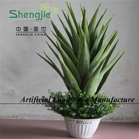 natural looking plastic plant, artificial sansevieria