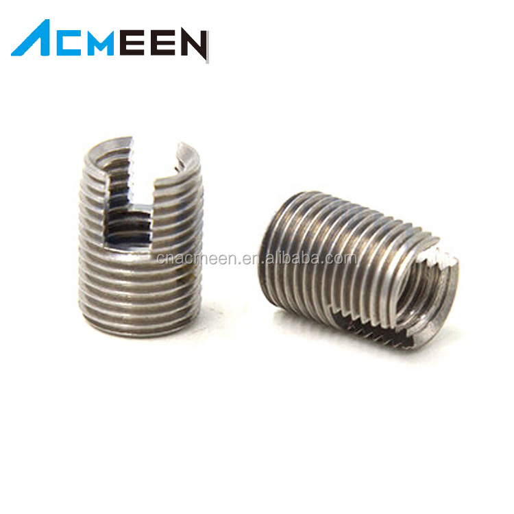 Slotting self tapping fastener thread inserts nuts
