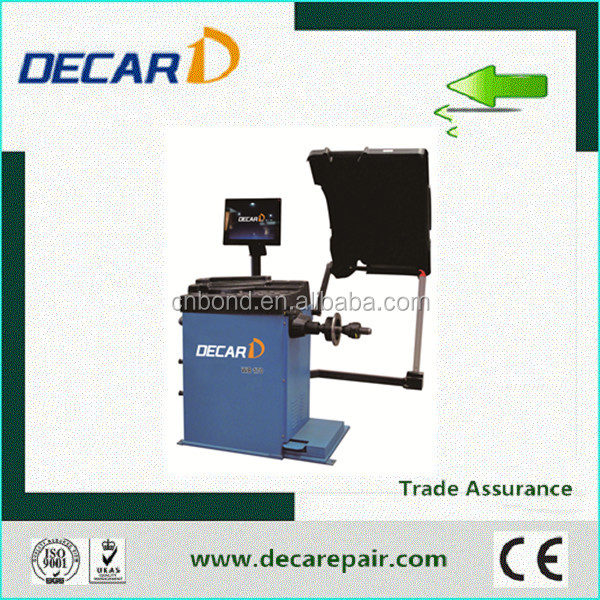 wheel alignment and balancing machine for tire repair shop