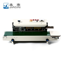 Continuous plastic bag sealing machine with date coding
