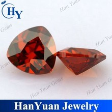 synthetic orange red trillion cut heat applied cubic zirconia