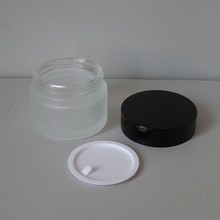 alibaba china frost 50g glass container company, unique glass container design with black cap