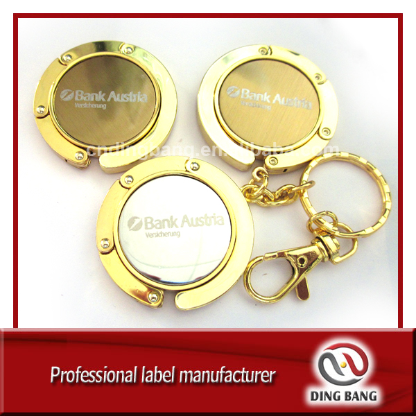 OEM Wholesale Stock Items Key chain Type And Promotion Souvenir Use Custom Blank Metal Gold Bag Hanger