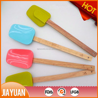 Silicone rubber scraper with long wooden handle