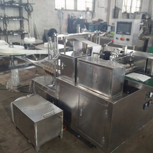 Alcohol swab packing machine