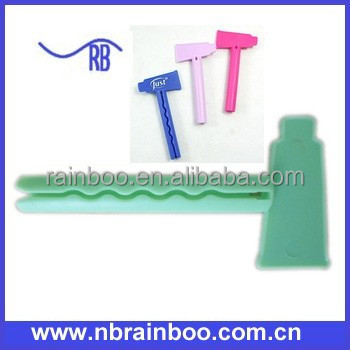 Logo printed hot selling promotional cheap plastic tube toothpaste squeezer AB113