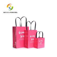 Excellent quality glossy printed gift package Plastic stripe paper bags