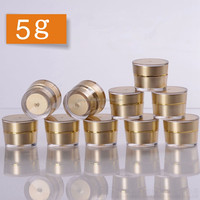 Luxury 5g acrylic gold cap cosmetic container small face cream eye jar