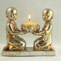 Happy cute monk statues with candle holder