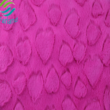 High quality 100% polyester knitted pink color brush style heart pattern pv plush fabric made in China