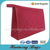 Hollowed out pink PVC leather zip cosmetic vanity case