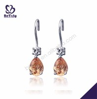 Simple design orange stone silver seed bead earring
