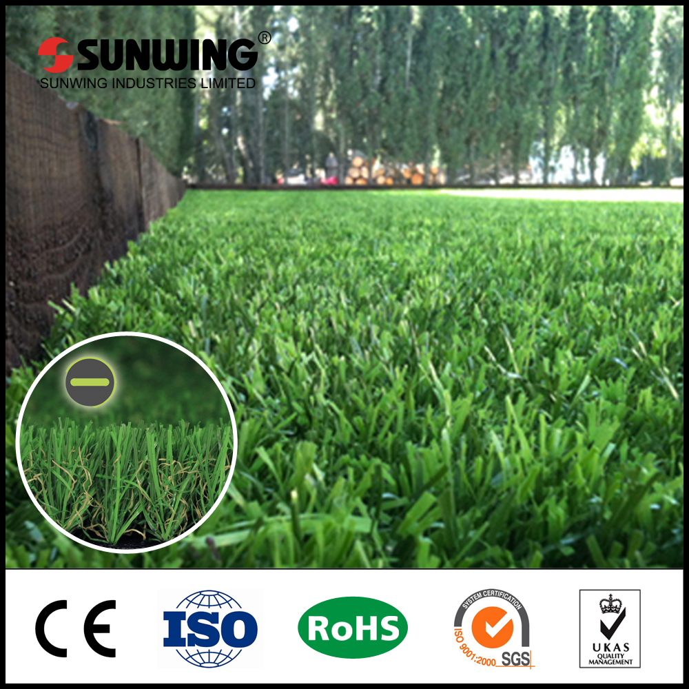 Colorful synthetic lawn fake grass in garden for residential landscape
