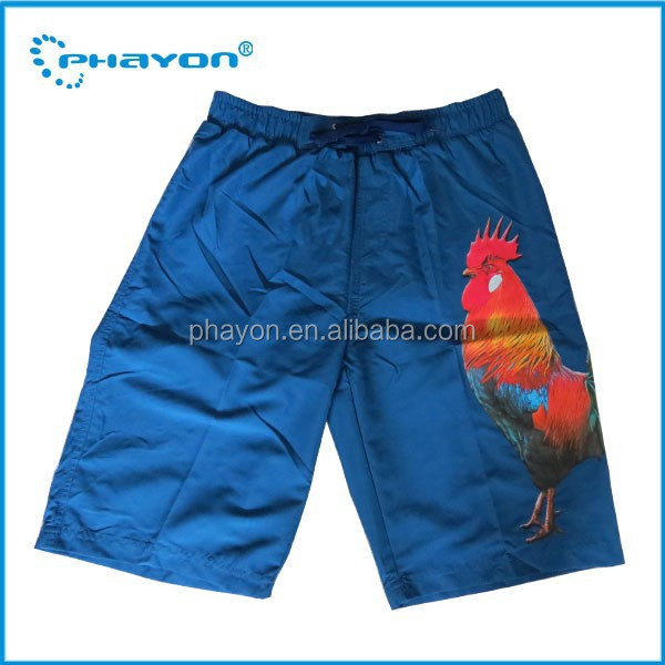 OEM&ODM wholesale young men polyester rubber print woven beach shorts