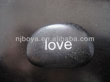 words imprinted on pebble stone, engraved river rock,river stone carving