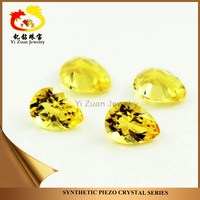 Synthetic piezoelectric quartz crystal gemstone pear shaped diamond facets cut citrine rough