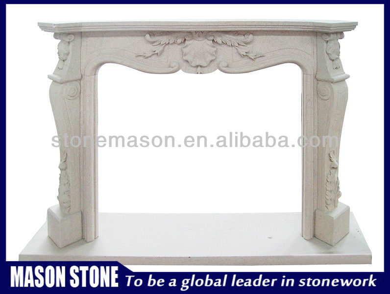 Carved white marble fire place
