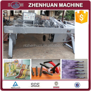 Automatic lace tipping machine with photocell device
