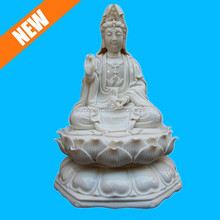 white porcelain buddha sitting on a lotus blossom for sale