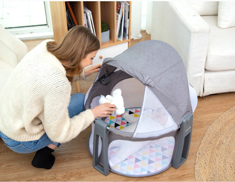 Popular and foldable baby travel cot with canopy and toys