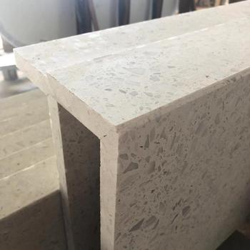 White engineered terrazzo stone with marble chips for counter and table tops