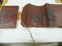 scroll leather journals made with custom silk screen printed covers in dragon theme patterns suitable for carrying in pockets