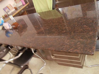 Tan Brown gangsaw granite in polished honed flamed leather finished antique finished in gangsaw cutter and tile sizes.