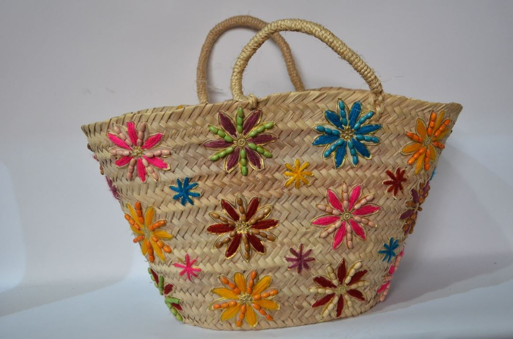 Palm leaf basket, decorated with floral patterns