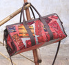 DYED WOOL KILIM TRAVEL BAG WITH LEATHER