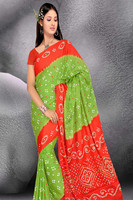 Kala Sanskruti Cotton satin saree with Dark saffron, parrot green color.