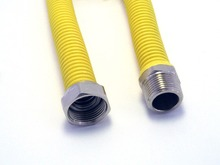 FLEXIBLE EXTENSIBLE HOSE FOR GAS BOILER (COVERED IN YELLOW POLYOLEFIN)