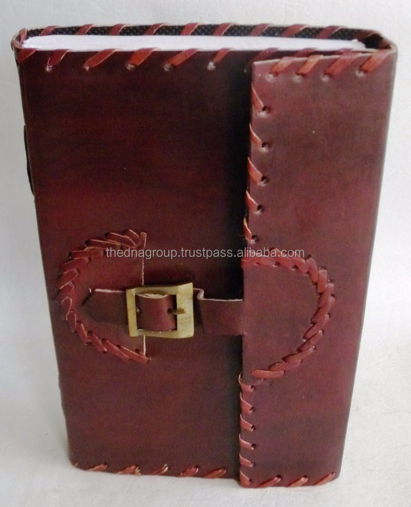 Handmade vintage embossed bit side stitched with belt buckle closure leather notebook