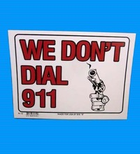 WE DONT DIAL 911 SIGN