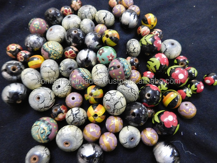 handmade wooden painted beads in assorted sizes and patterns suitable for jewelry designers