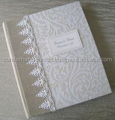 white wedding photo albums made with custom printed cover designs as per client specifications in size 8 *10 inches with 32 page