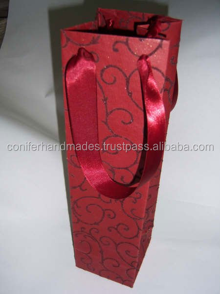 flock printed handmade paper wine bottle bags with satin ribbon handles suitable for wine stores and for wine manufacturers