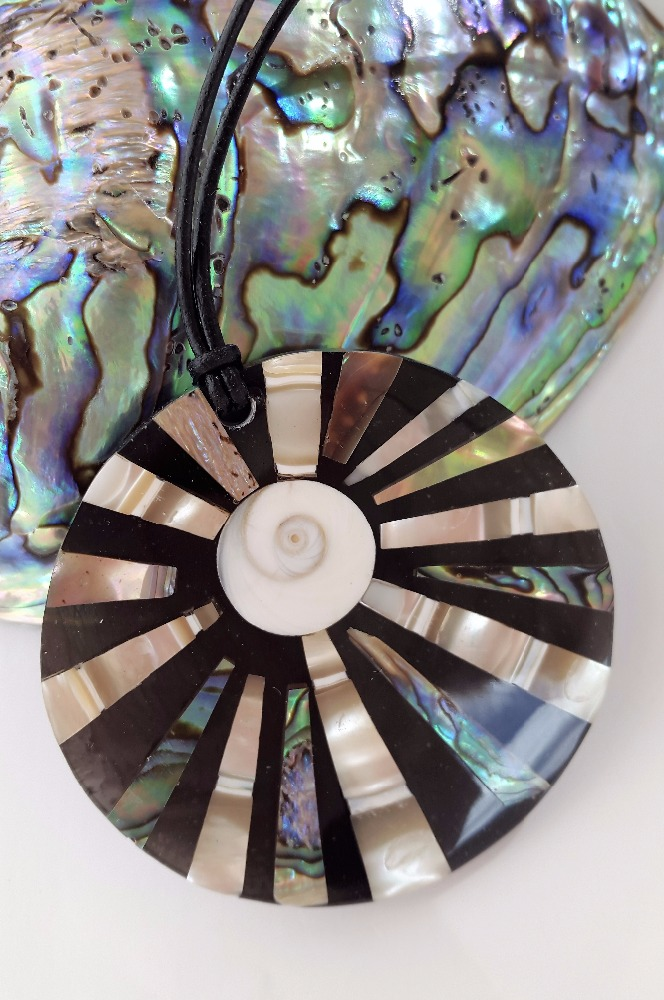 Mother of pearl, paua shell handcrafted fashion jewelry necklace on leather cord.