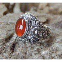 Silver ring motif bun carving with carnelian stone