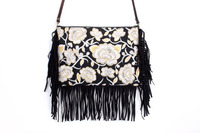 Dazelling Cross Body With A White Magnolia Embroidered Pattern, Adorned With Black Leather Tassel