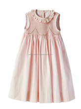 Pink smocked children girl dress in cotton poplin