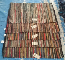 stock lot of multi leather rugs with fringes