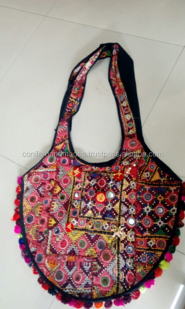 patchwork fabric banjara theme bags with mirrors and pom poms made from recycled fabric