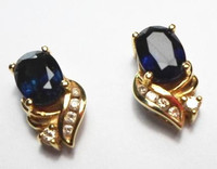 Majestic genuine dark blue sapphire and diamond stud earrings wrapped in 18k (750) yellow gold. 12mm height