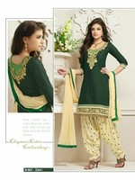 Sizzling stylish green & cream heavy embroidered & hand work cool patiayala kesi fabric salwar kameez