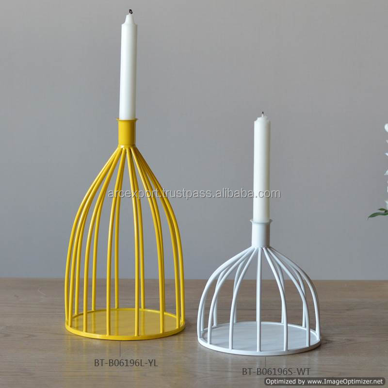 yellow and white colour iron candle holder