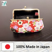 made in Japan cosmetic bag with metal clasp closure covered with quality crepe fabric